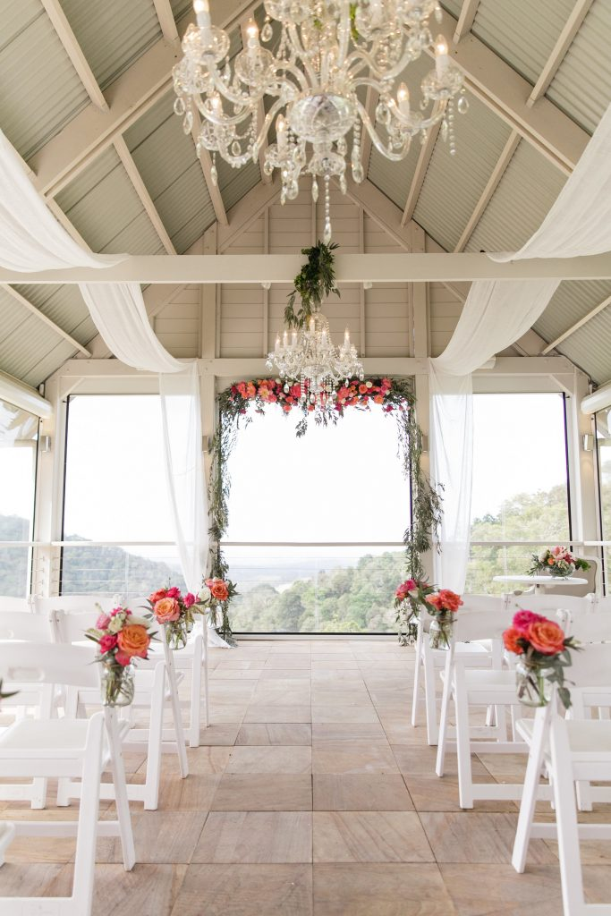 Ceremony flowers in coral and pink tones