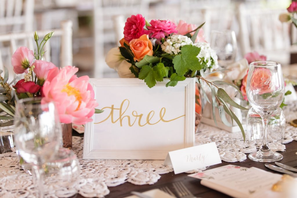 Reception flowers featuring coral peonies