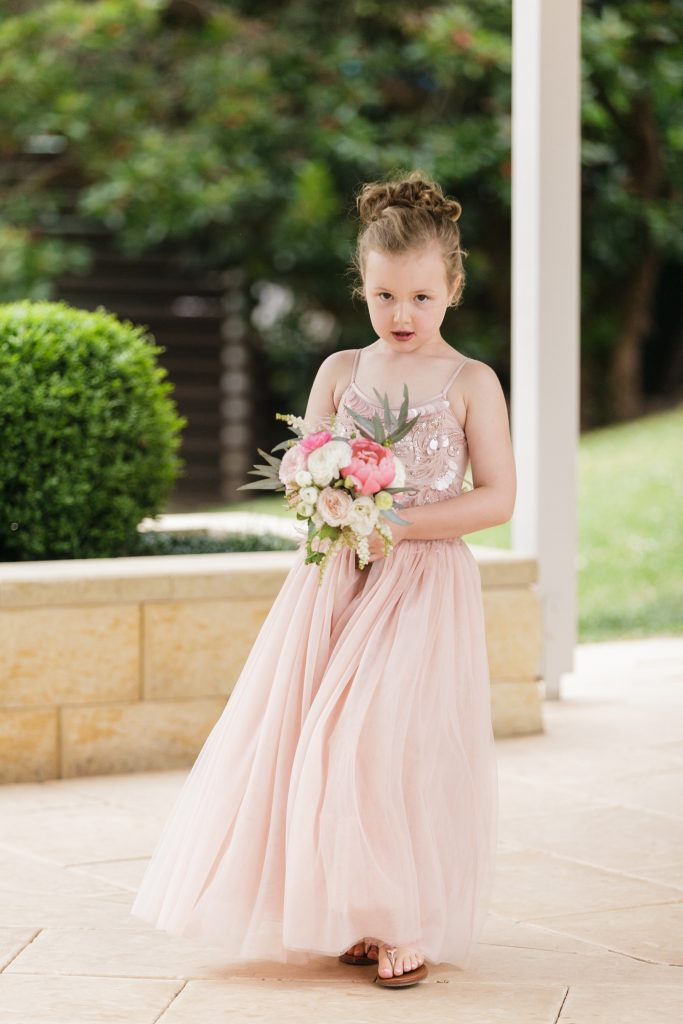 Flower girl bouquet featuring peonies