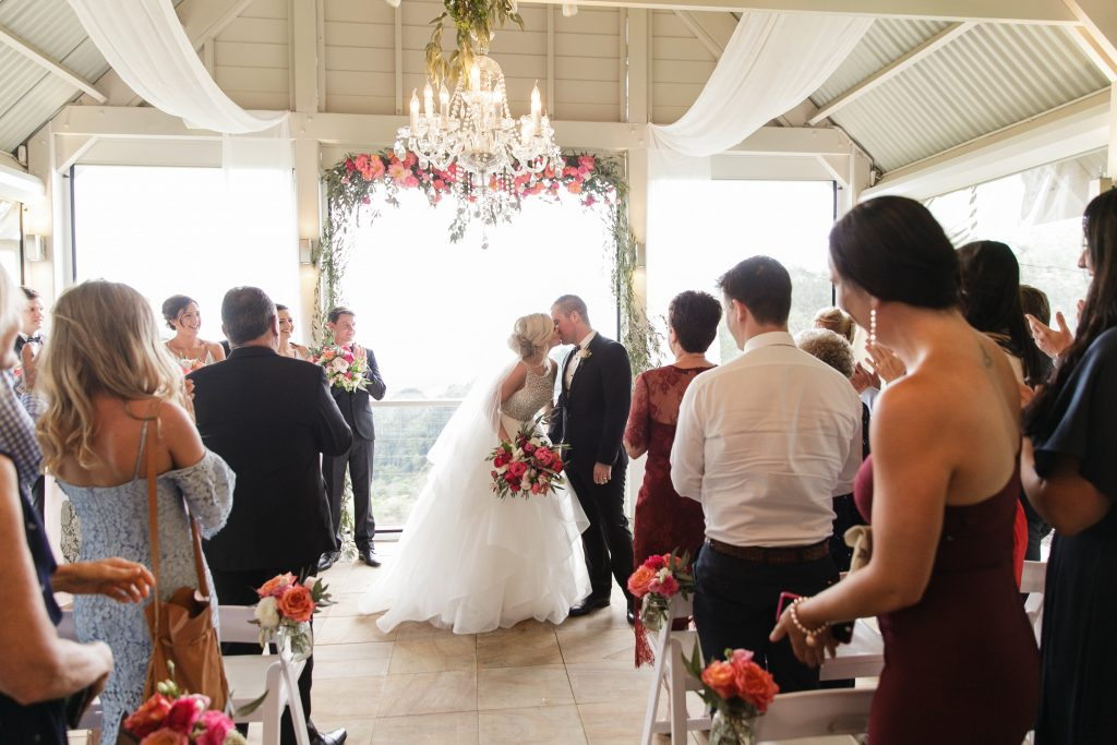 Hanging ceremony structure featuring coral blooms