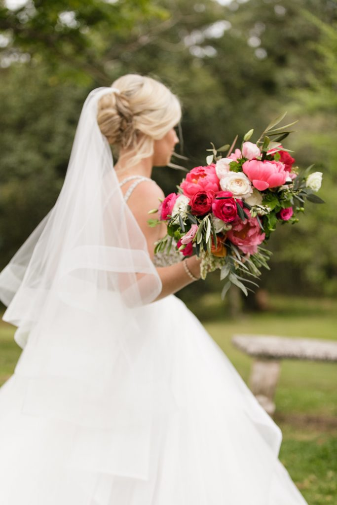 Wedding bouquet featuring coral peonies