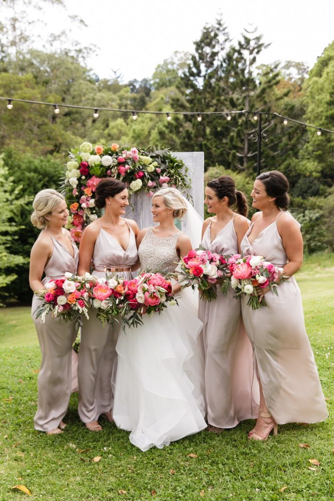 Wedding bouquets featuring coral peonies
