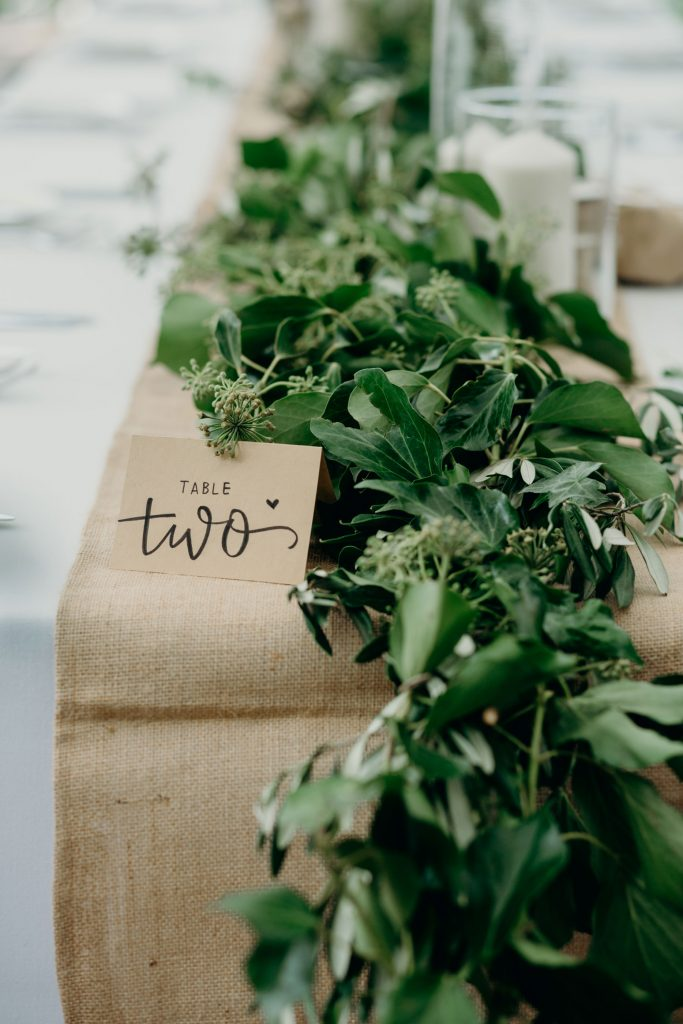 Reception tables with greenery garlands