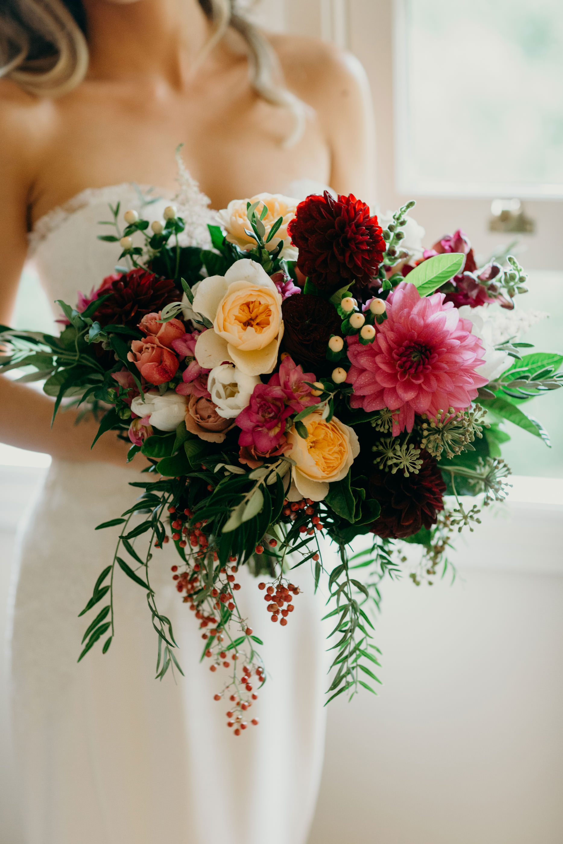 Winter wedding bouquet featuring dahlias