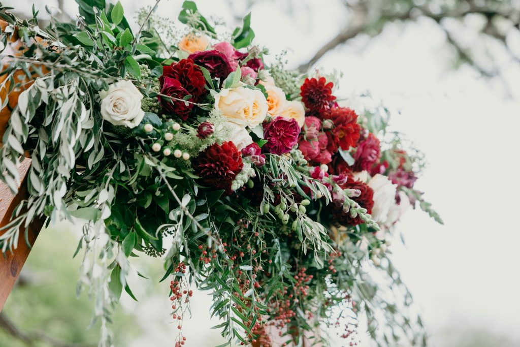 Ceremony arbour flowers featuring roses and dahlias