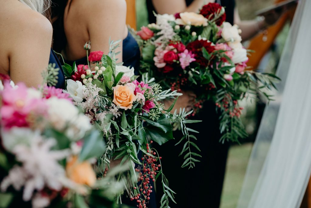 Whimsical wedding bouquets in rich tones