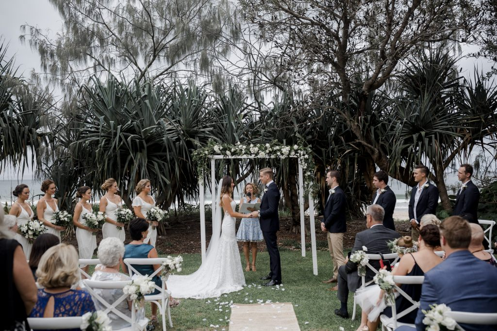 Ceremony canopy design featuring white blooms and lush greenery