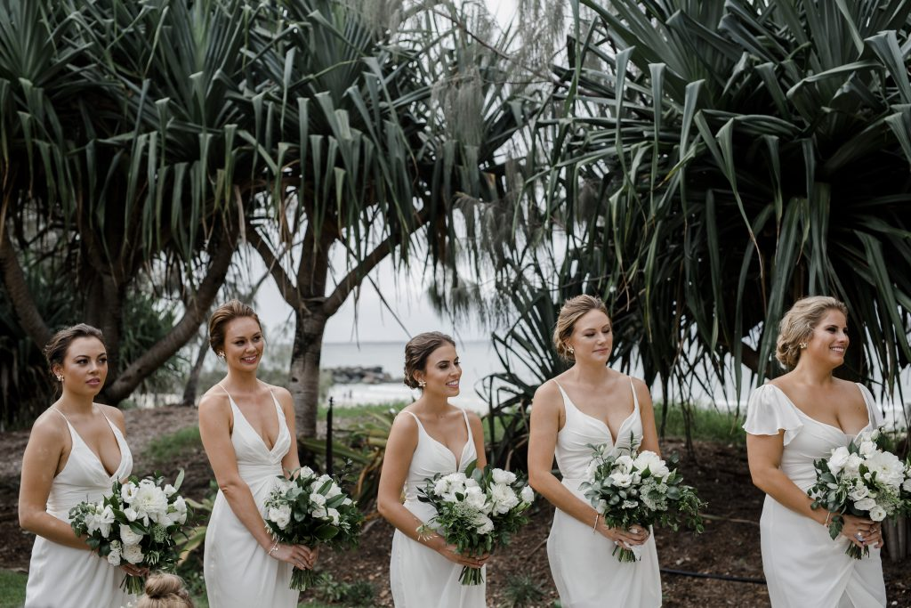 Modern white wedding bouquet featuring dahlias and lush greenery