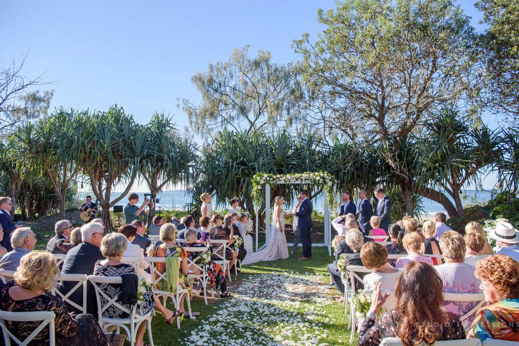 Lush white and green wedding canopy featuring roses