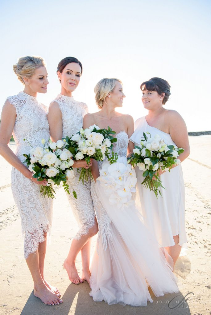 Lush white and green wedding bouquets featuring roses