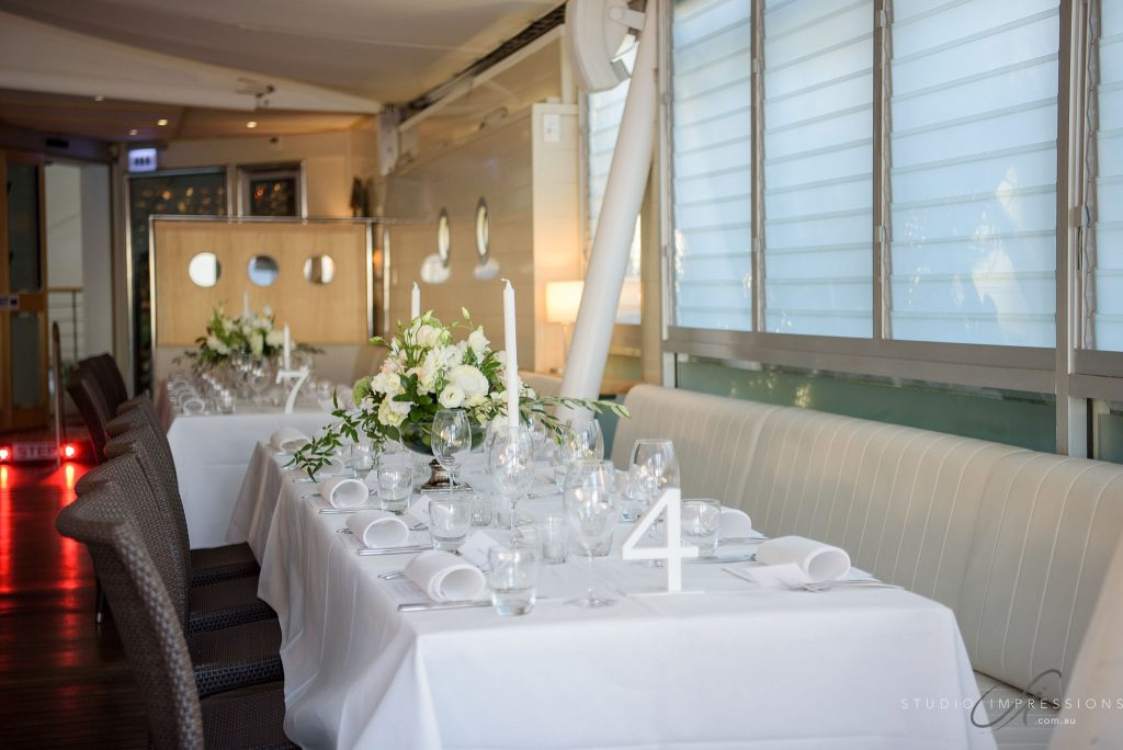 Glass chalice reception vases with white florals