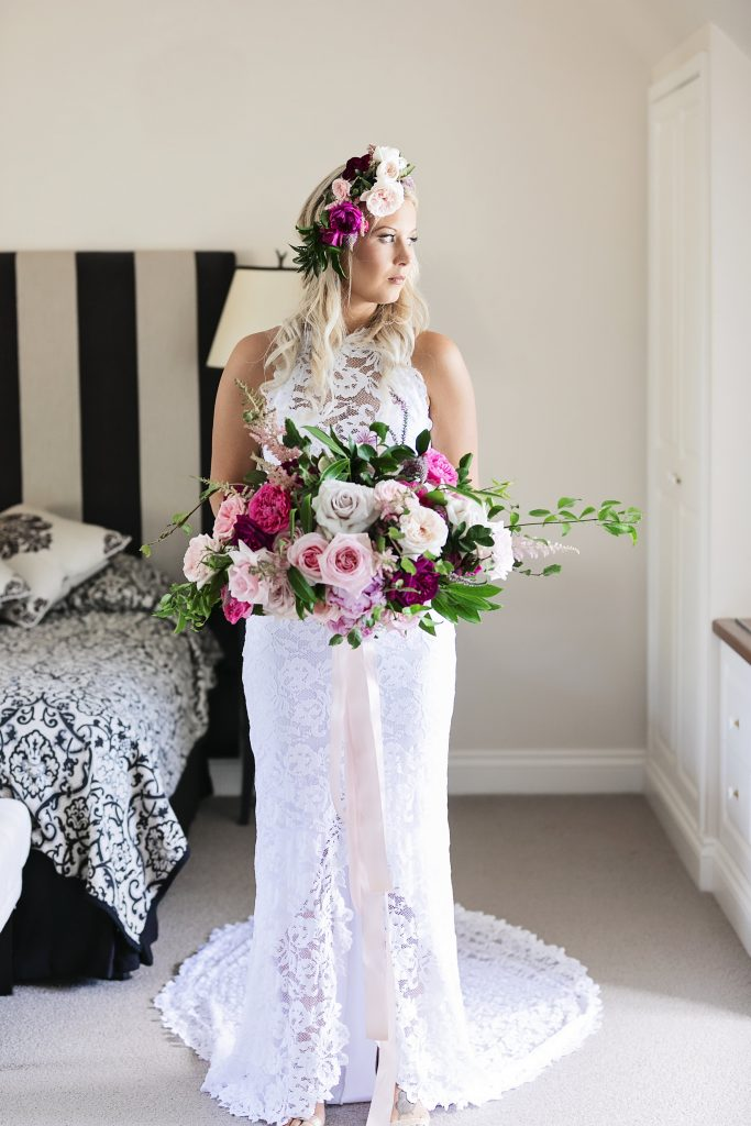 Crescent style wedding bouquet in pink tones