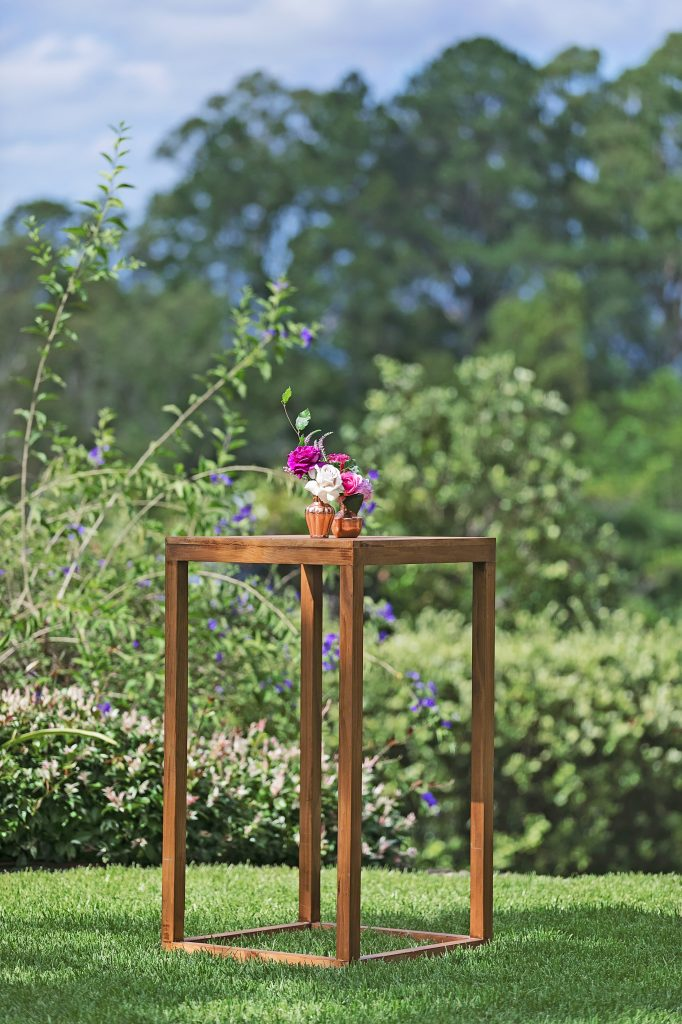 High bar featuring copper vases with roses