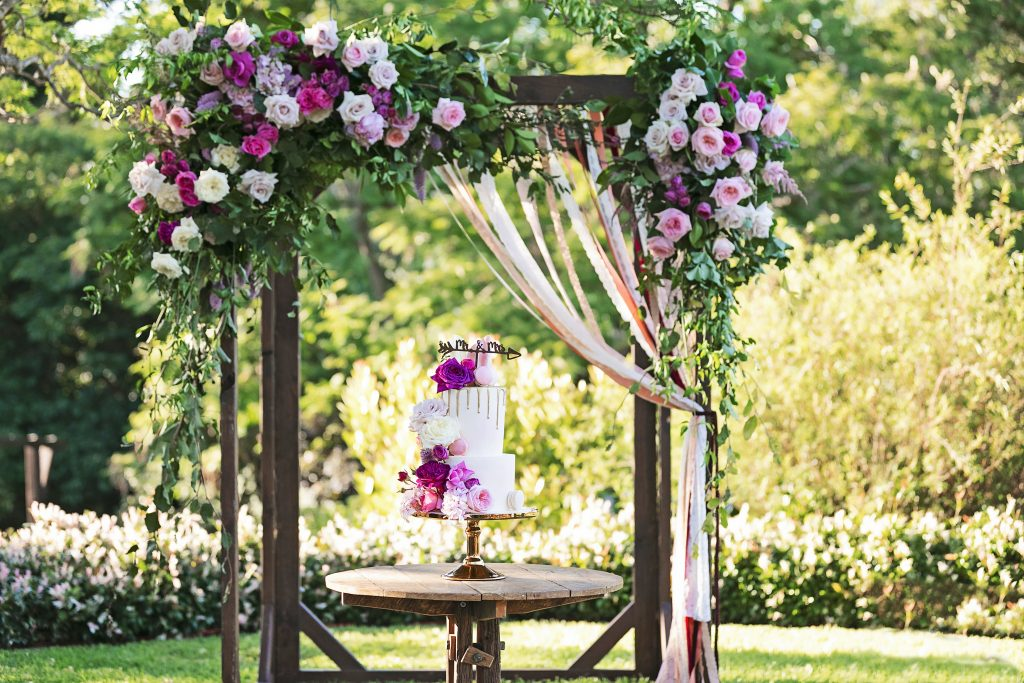 Timber arbour with floral feature in pink tones