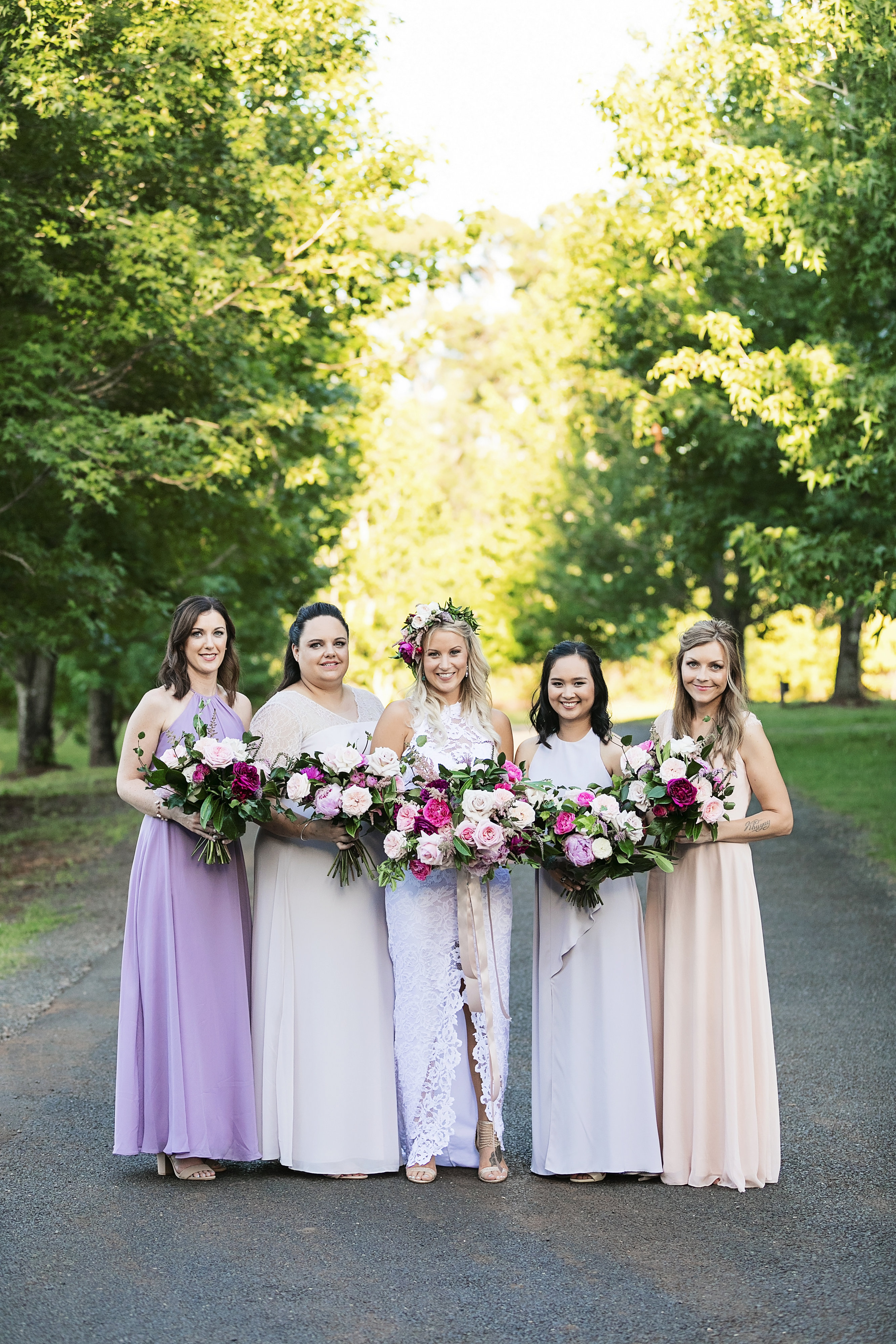 Modern pink wedding bouquets featuring roses