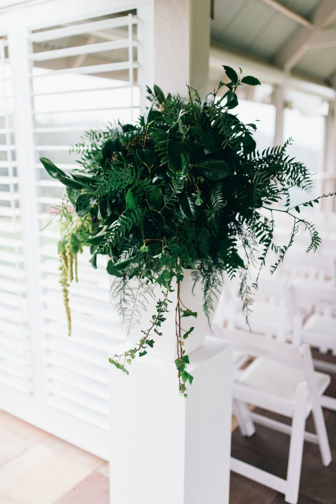 Ceremony feature designs with greenery