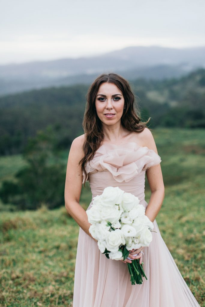 Modern chic white wedding bouquet featuring roses