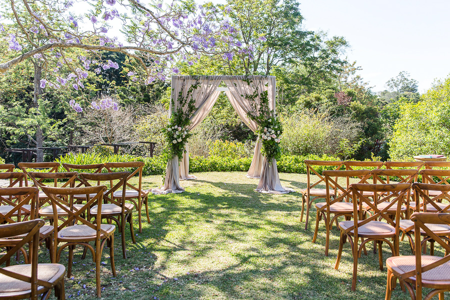Ceremony canopy design with trailing greenery