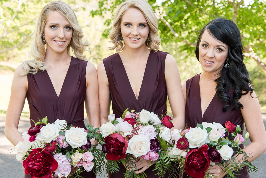 Rich toned wedding bouquets featuring peonies