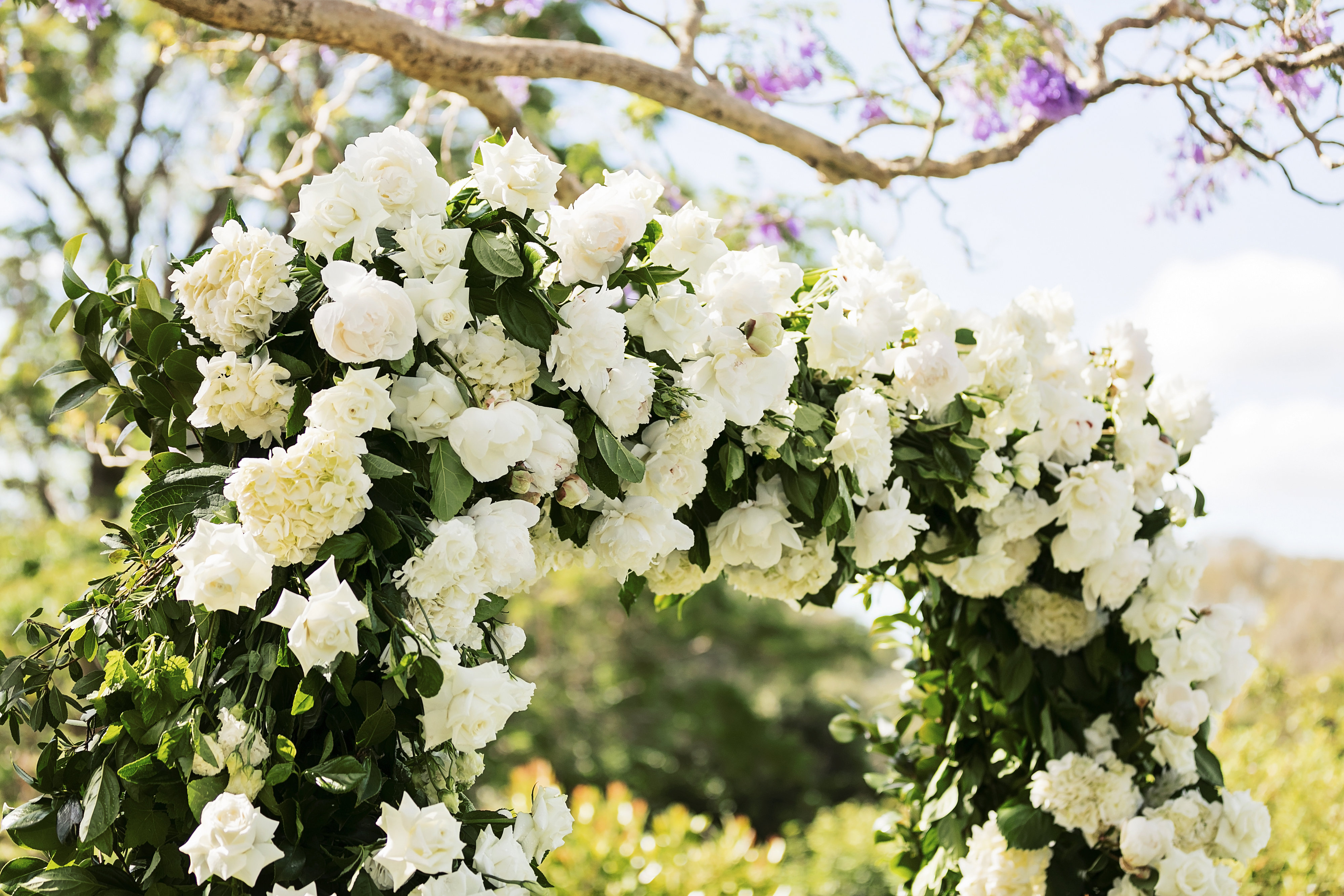 Ceremony arbour flowers featuring white peonies