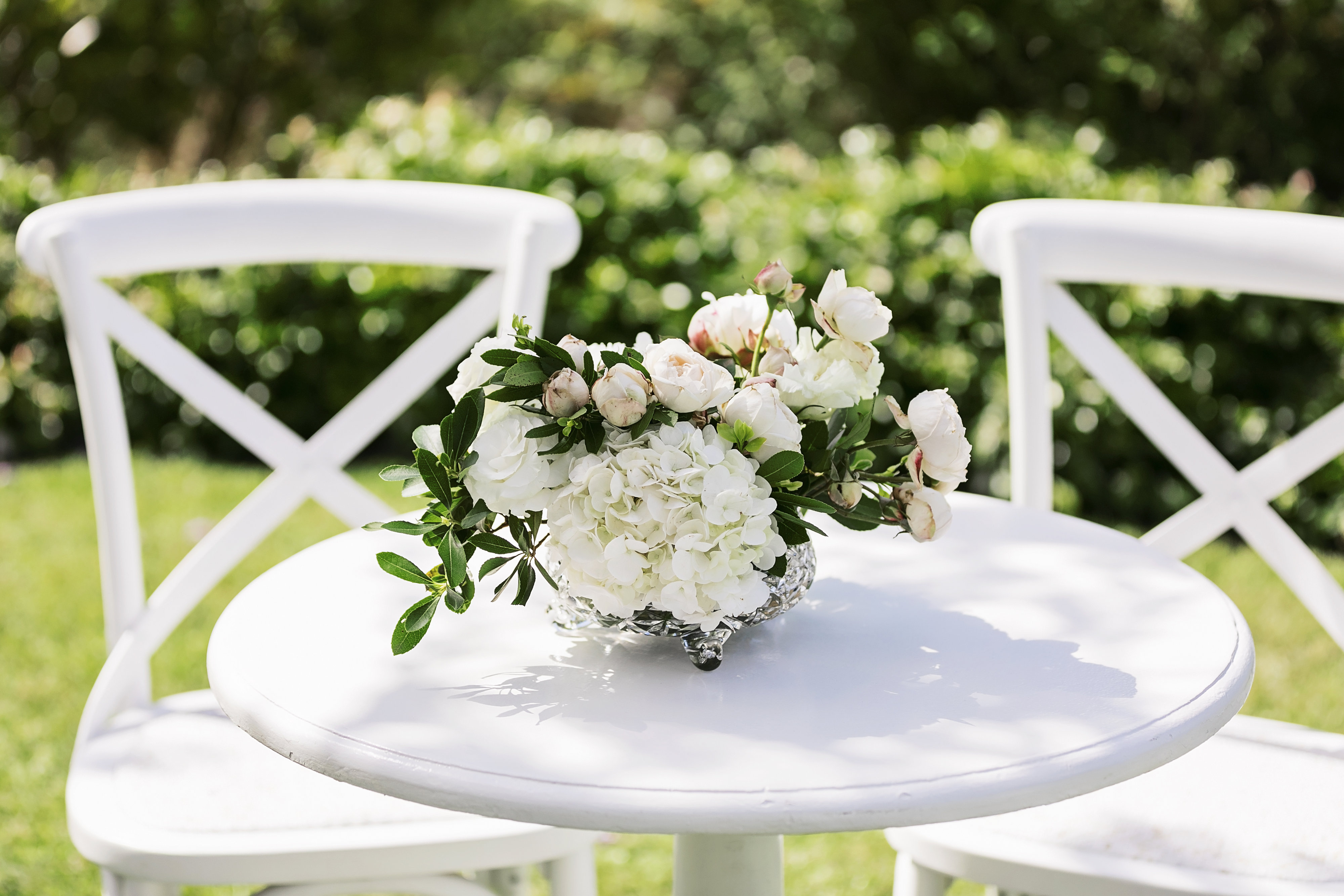 Registry design with lush greenery and white blooms