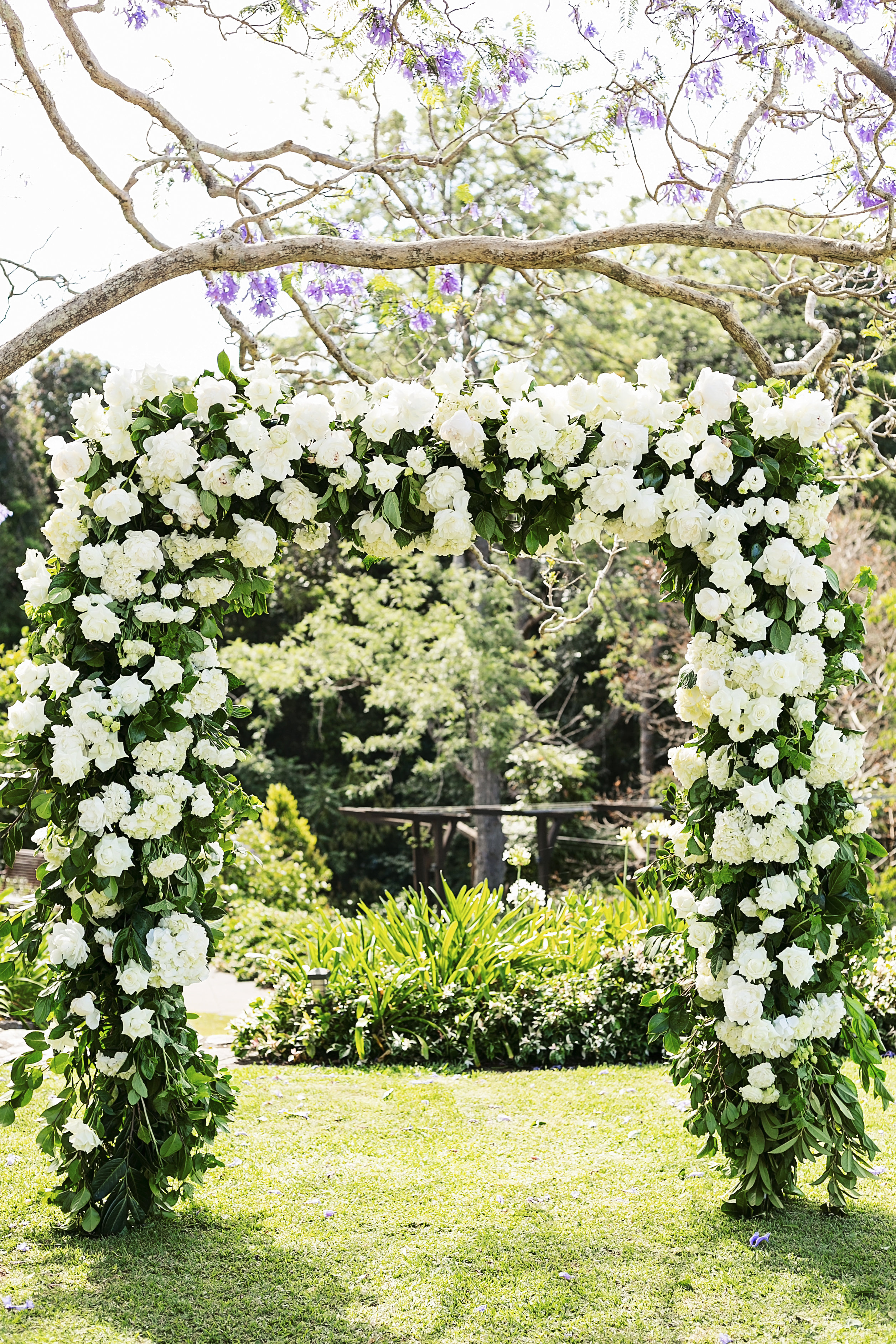 Ceremony arbour featuring white peonies and hydrangea