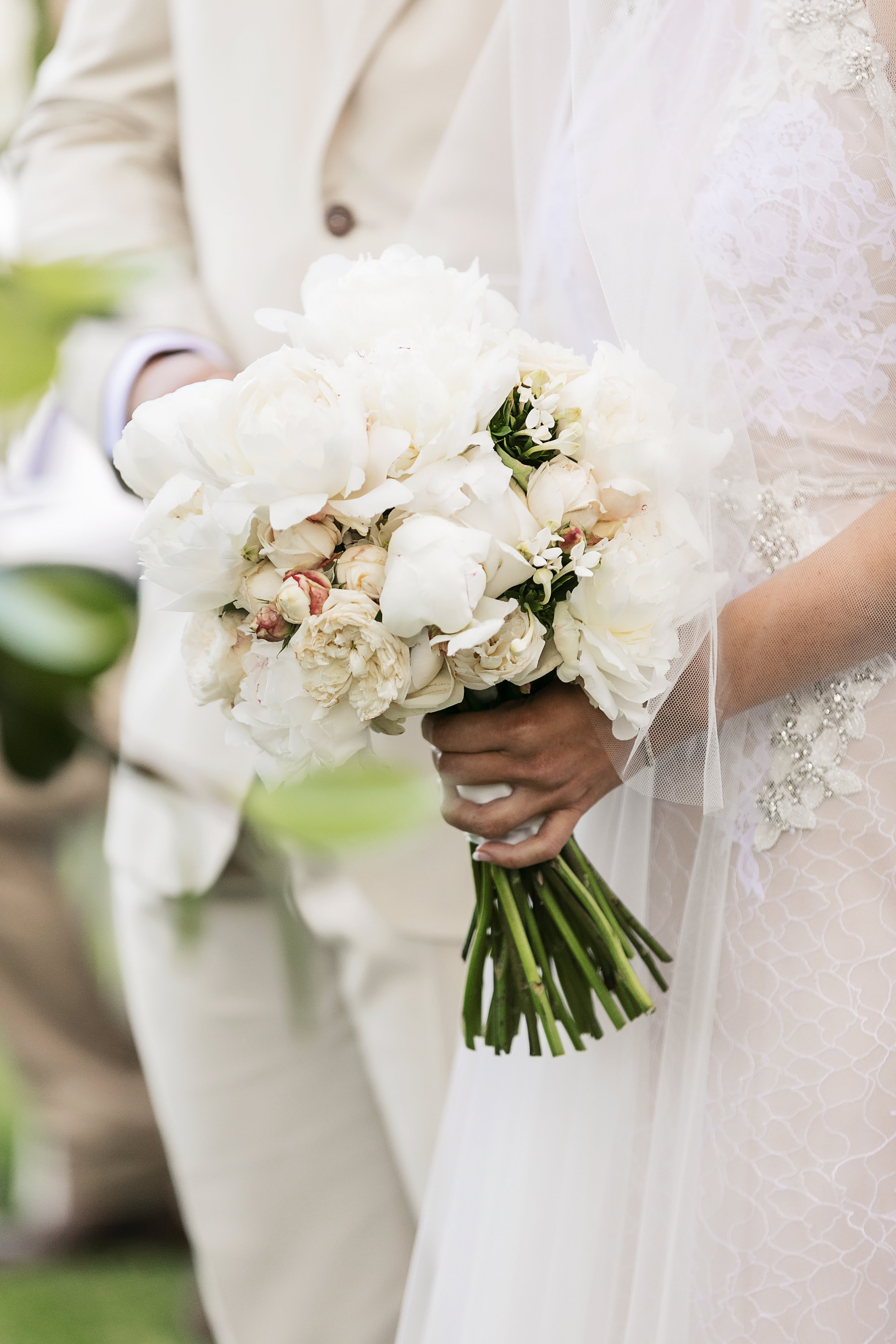White wedding bouquet of peonies and David Austin roses
