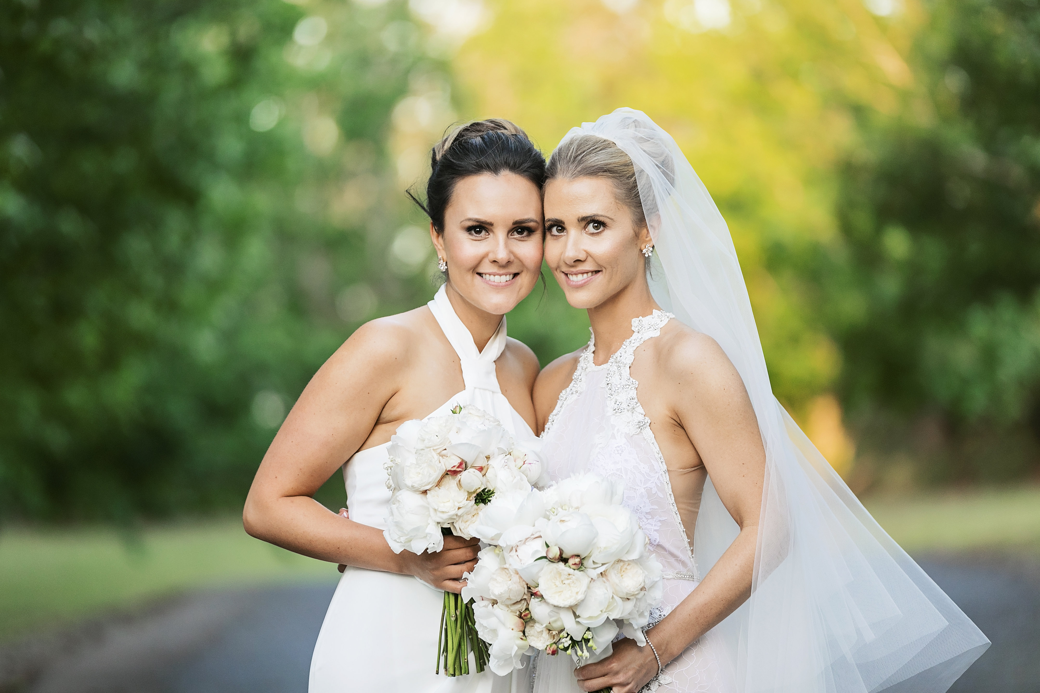 White wedding bouquets featuring peonies and David Austin roses