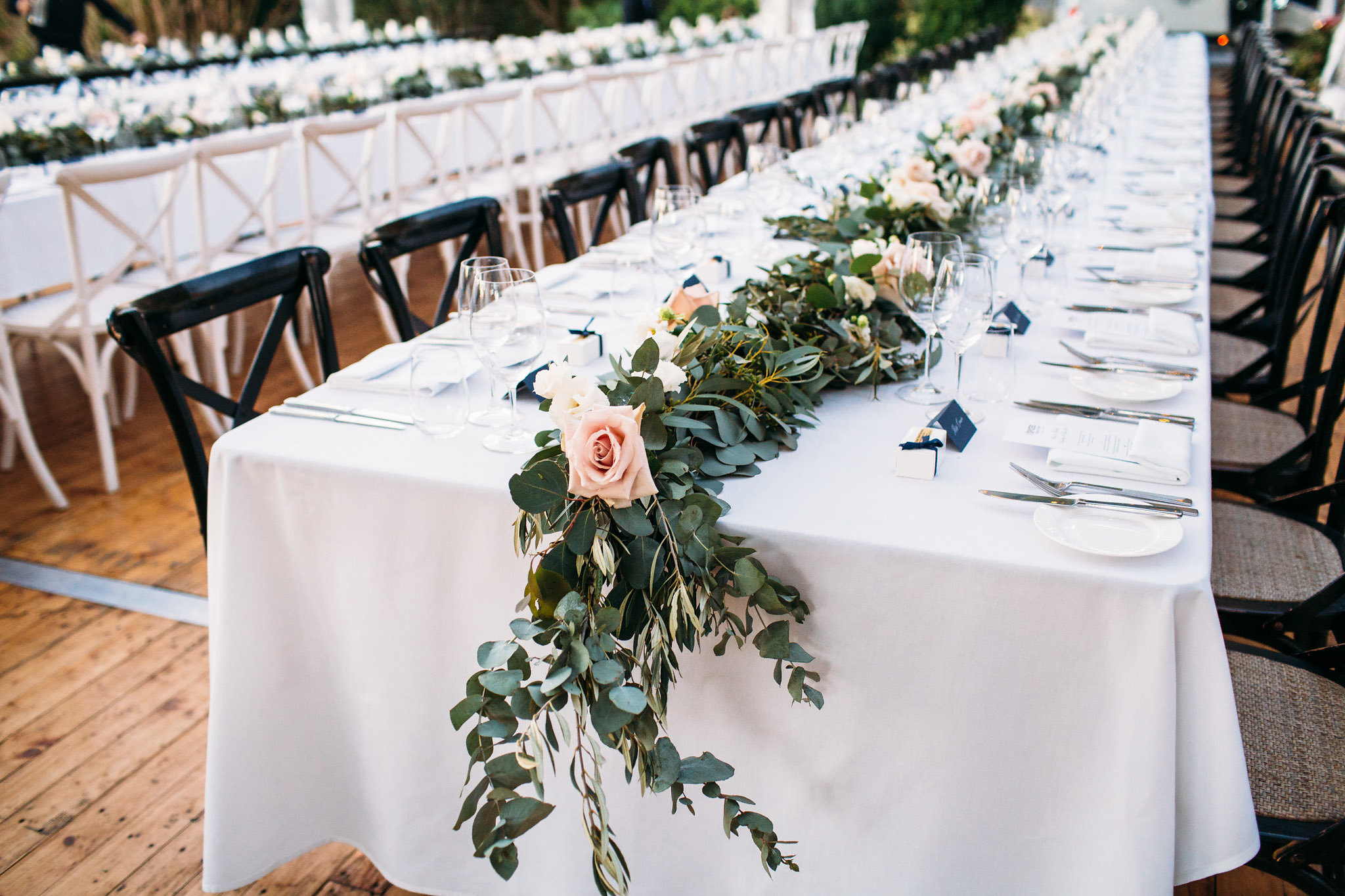 Rustic garland table runners featuring gum and Quicksand roses