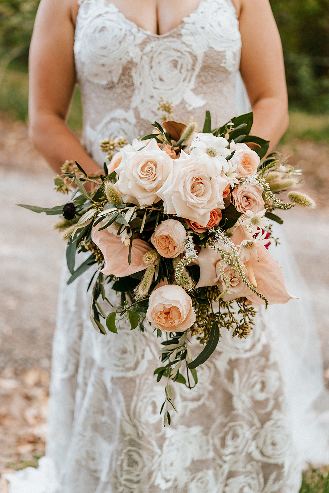 Modern wedding bouquet in peach tones