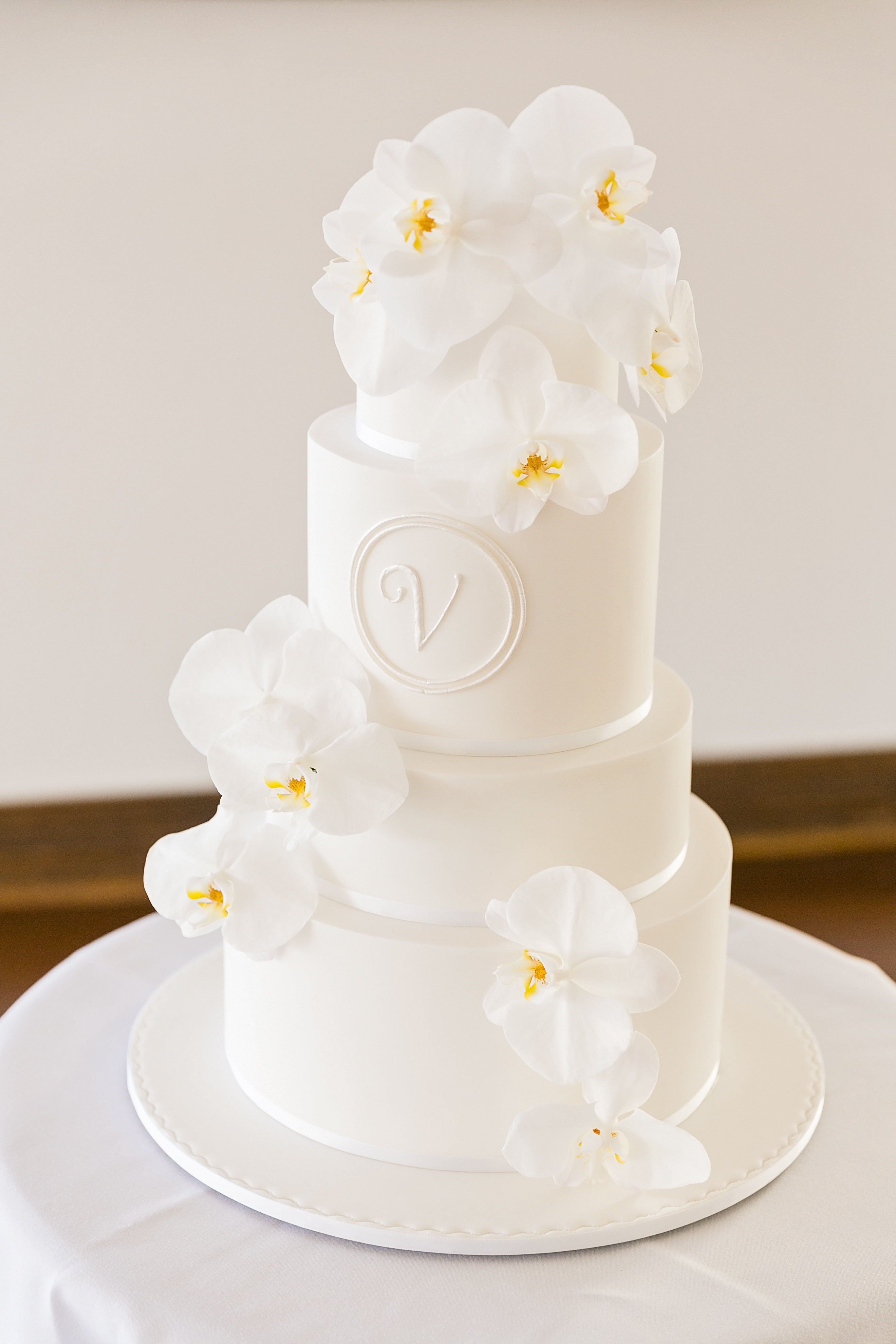 Wedding cake featuring orchid blooms