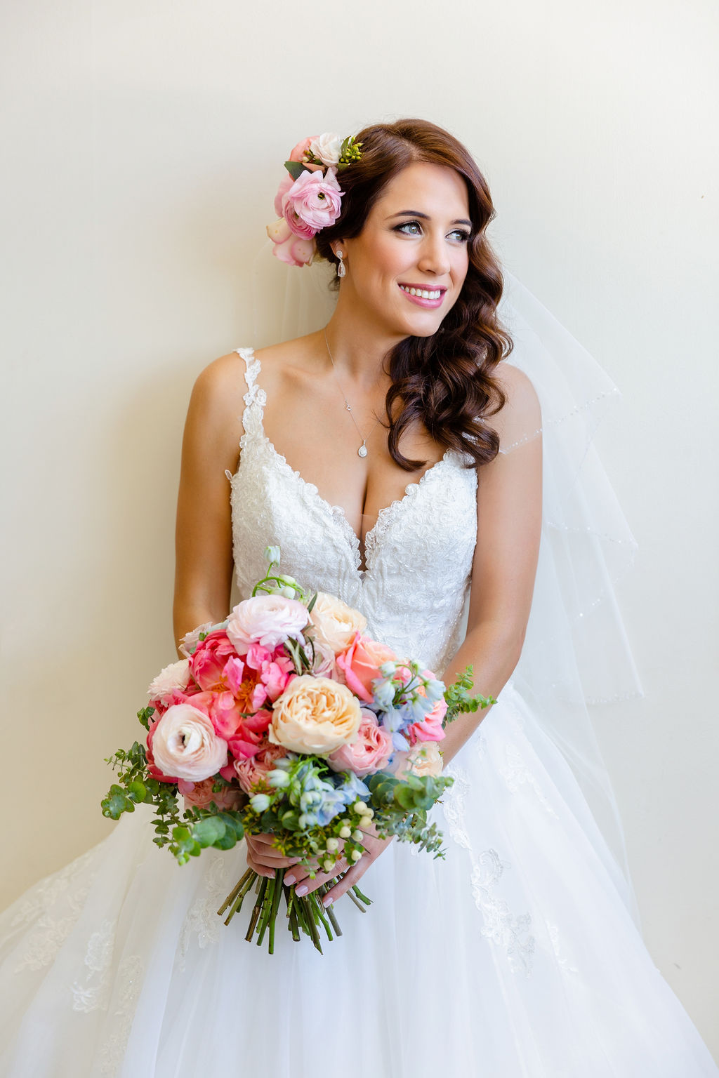 Pretty pastel wedding bouquet featuring peonies, roses and ranunculus