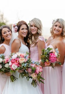 Pretty pastel wedding bouquets featuring coral peonies, ranunculus and gum