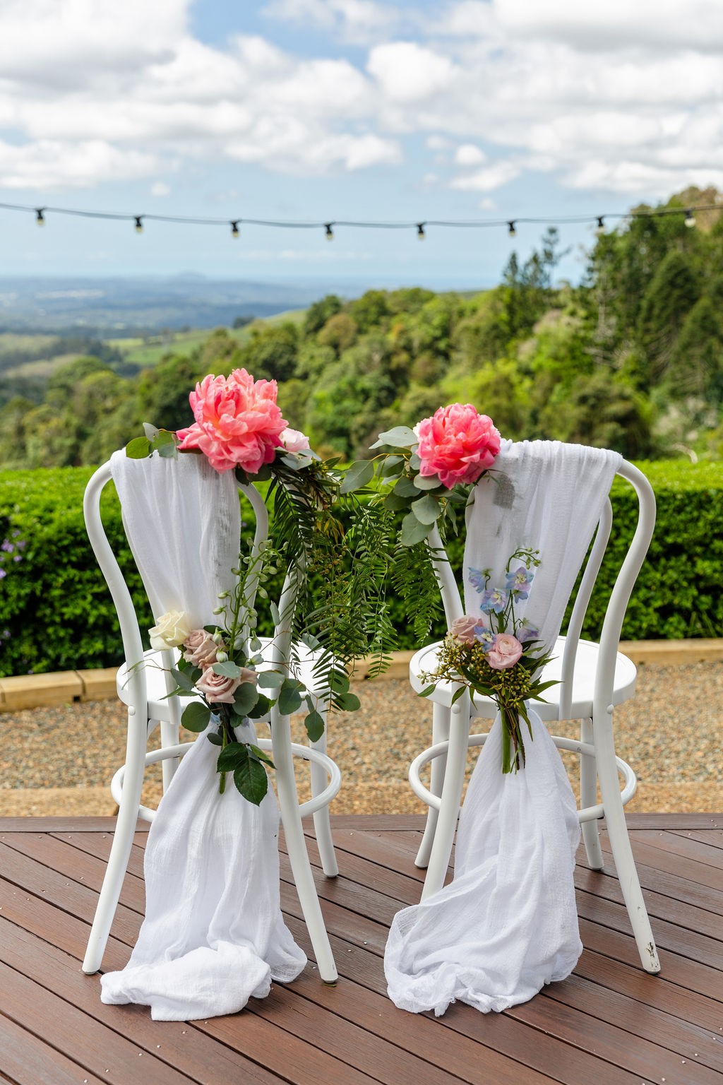 Chair floral feature with coral peonies
