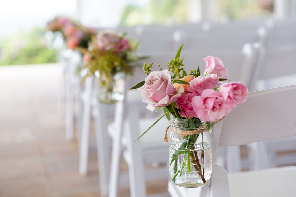Ceremony chair jars featuring pastel florals