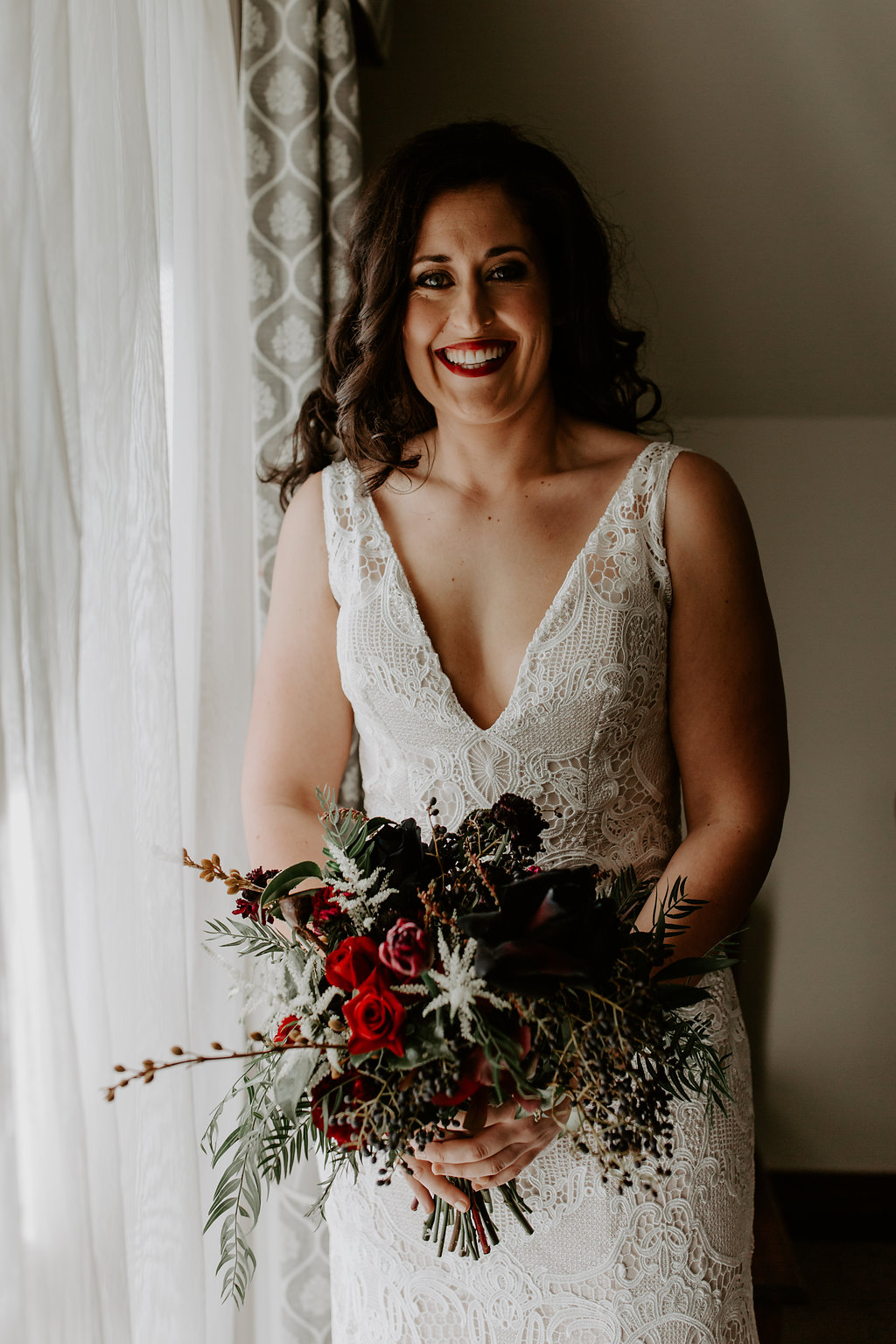 Romantic bridal bouquet in red and black tones