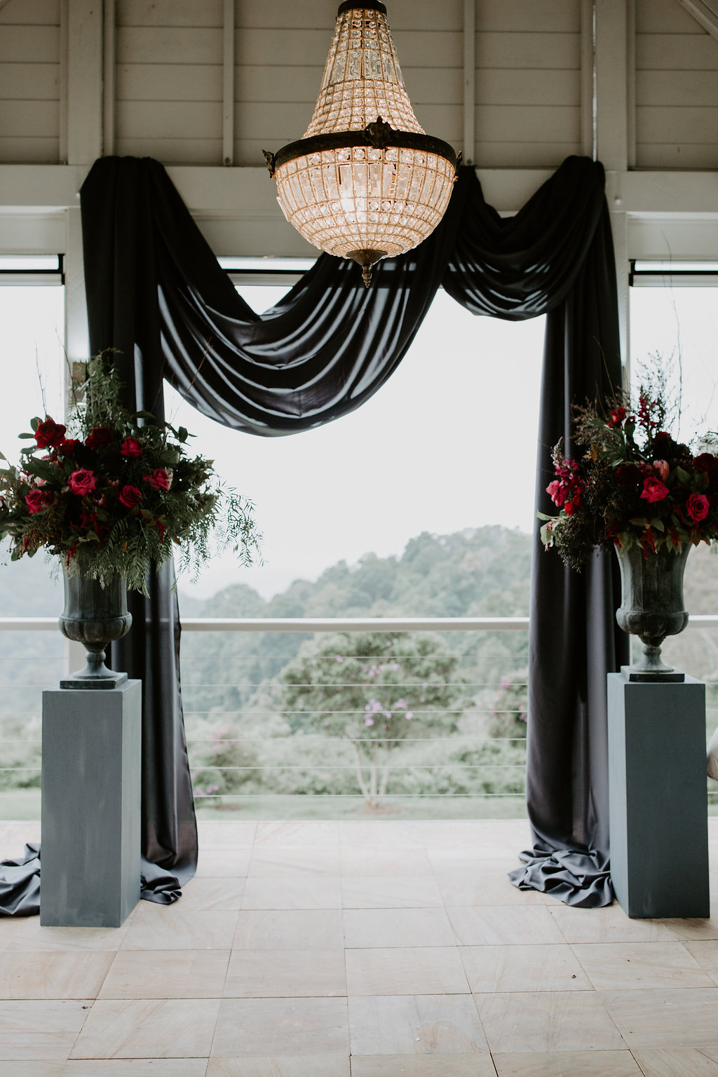 Ceremony urns featuring roses and proteas