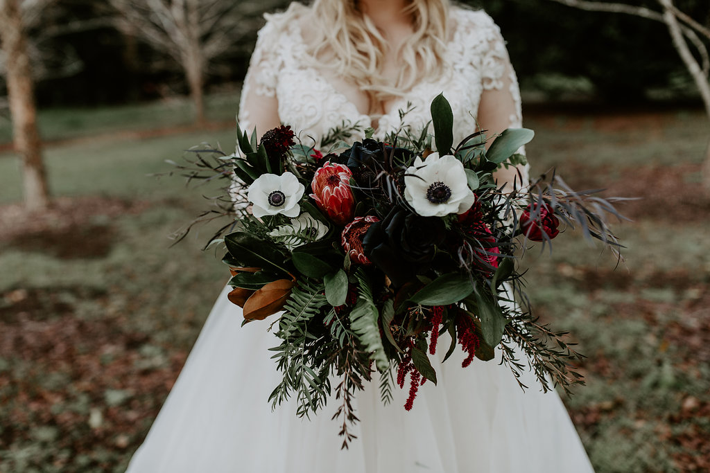 Romantic bridal bouquet featuring rich tones