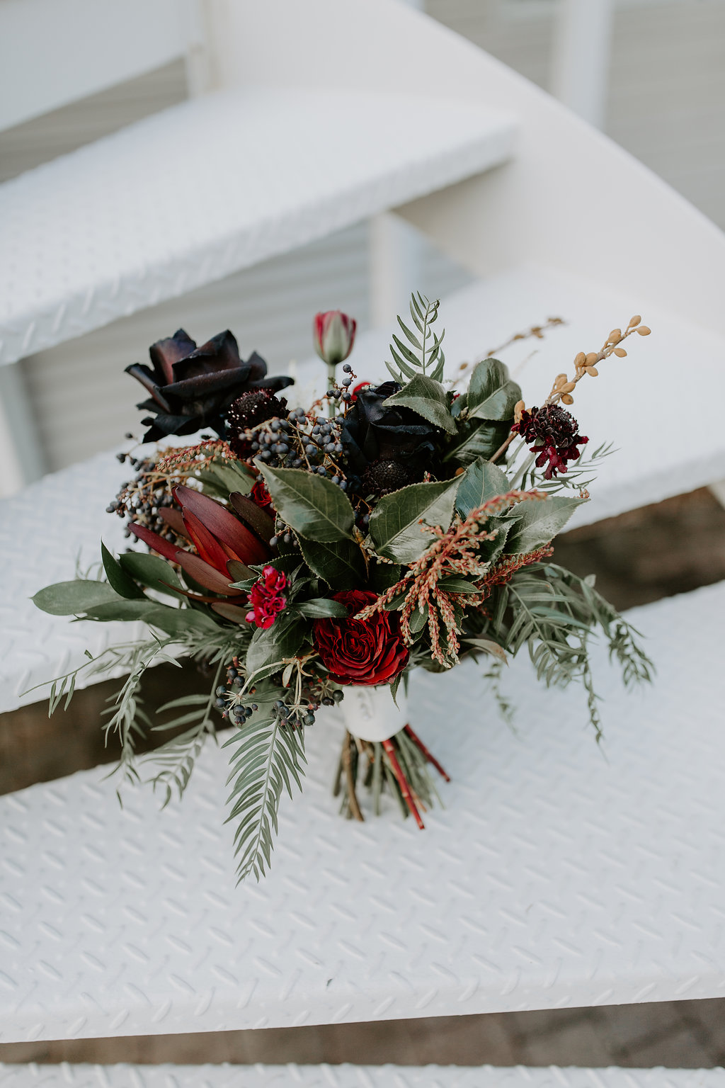 Bridal bouquet in rich tones featuring black roses