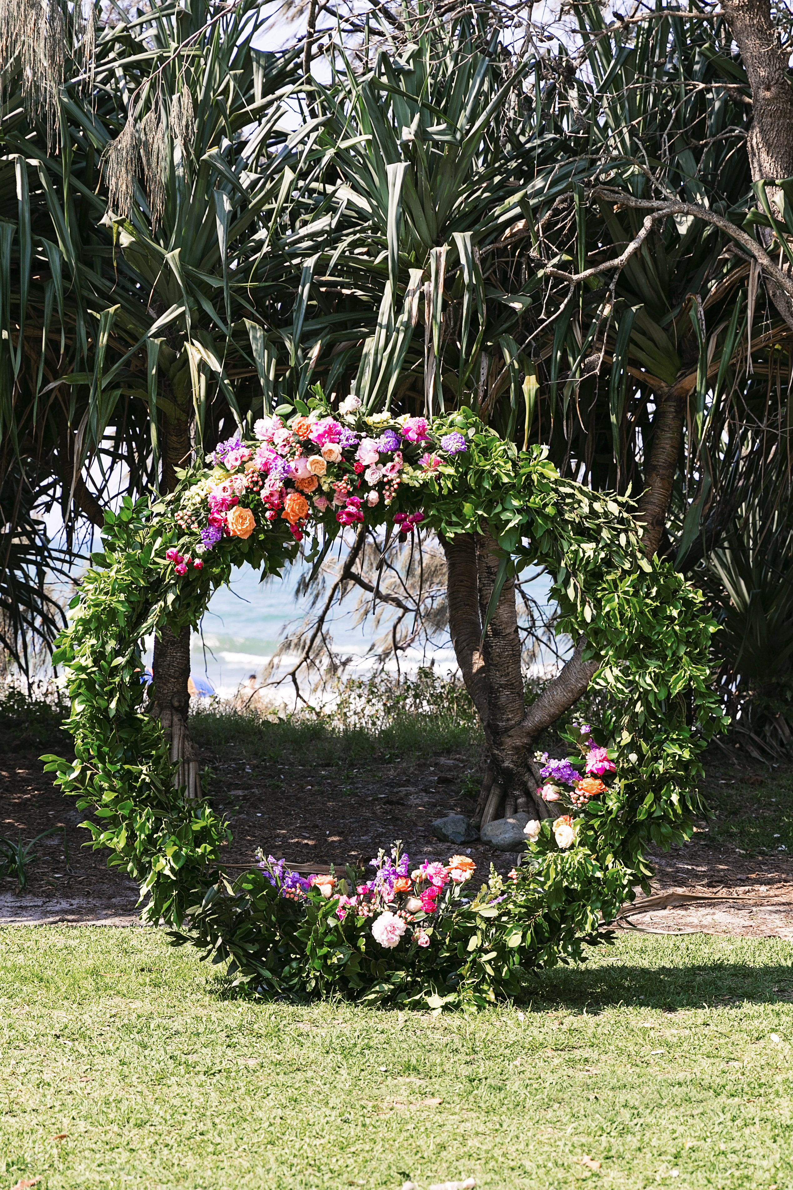 Round ceremony wedding structure featuring bright flowers and peonies