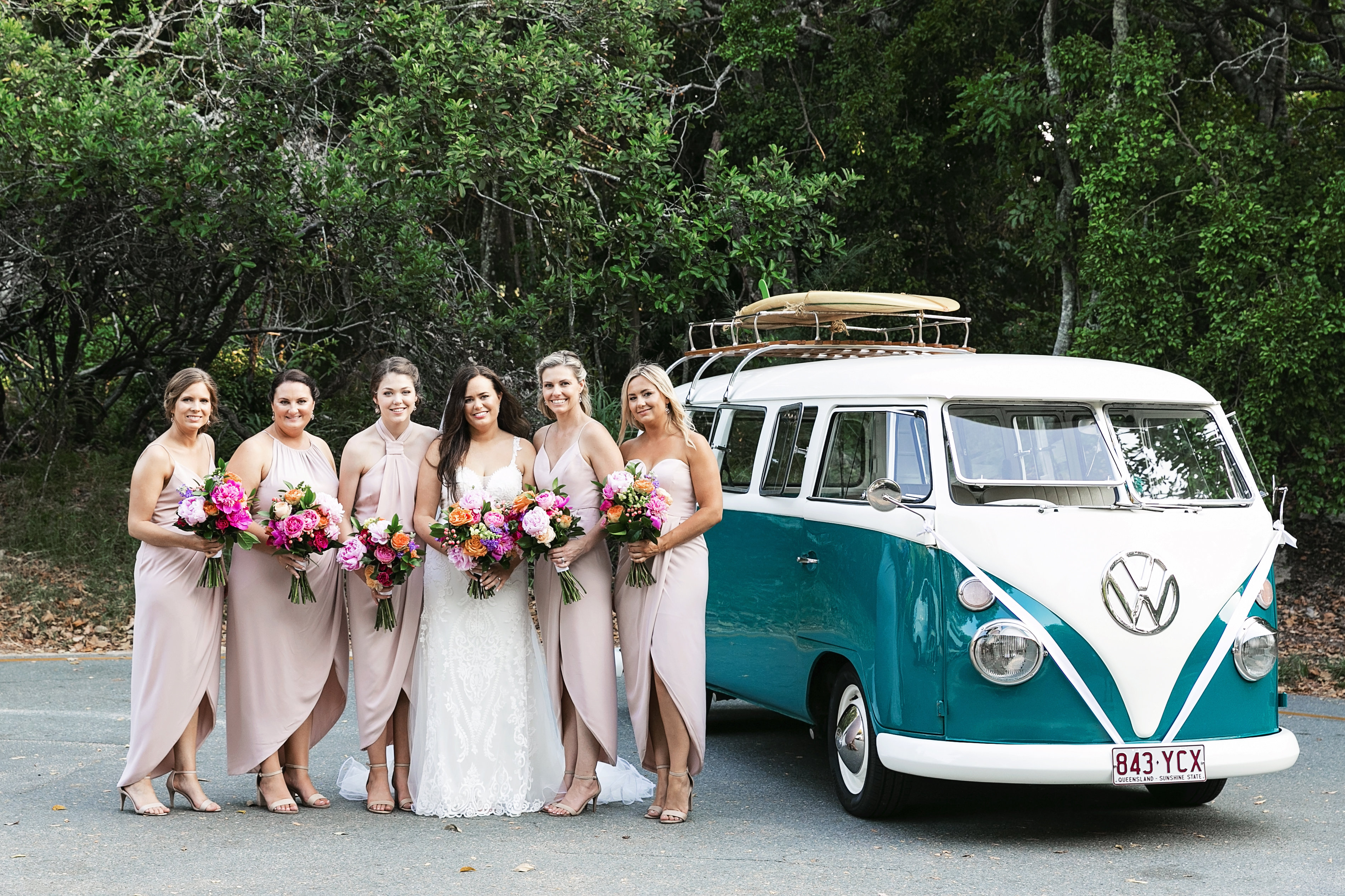 Noosa wedding at Sails Restaurant featuring colourful blooms and pink peonies.