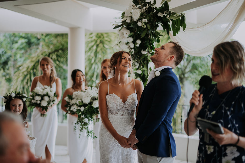 Ceremony arbour flowers in white and lush green tones