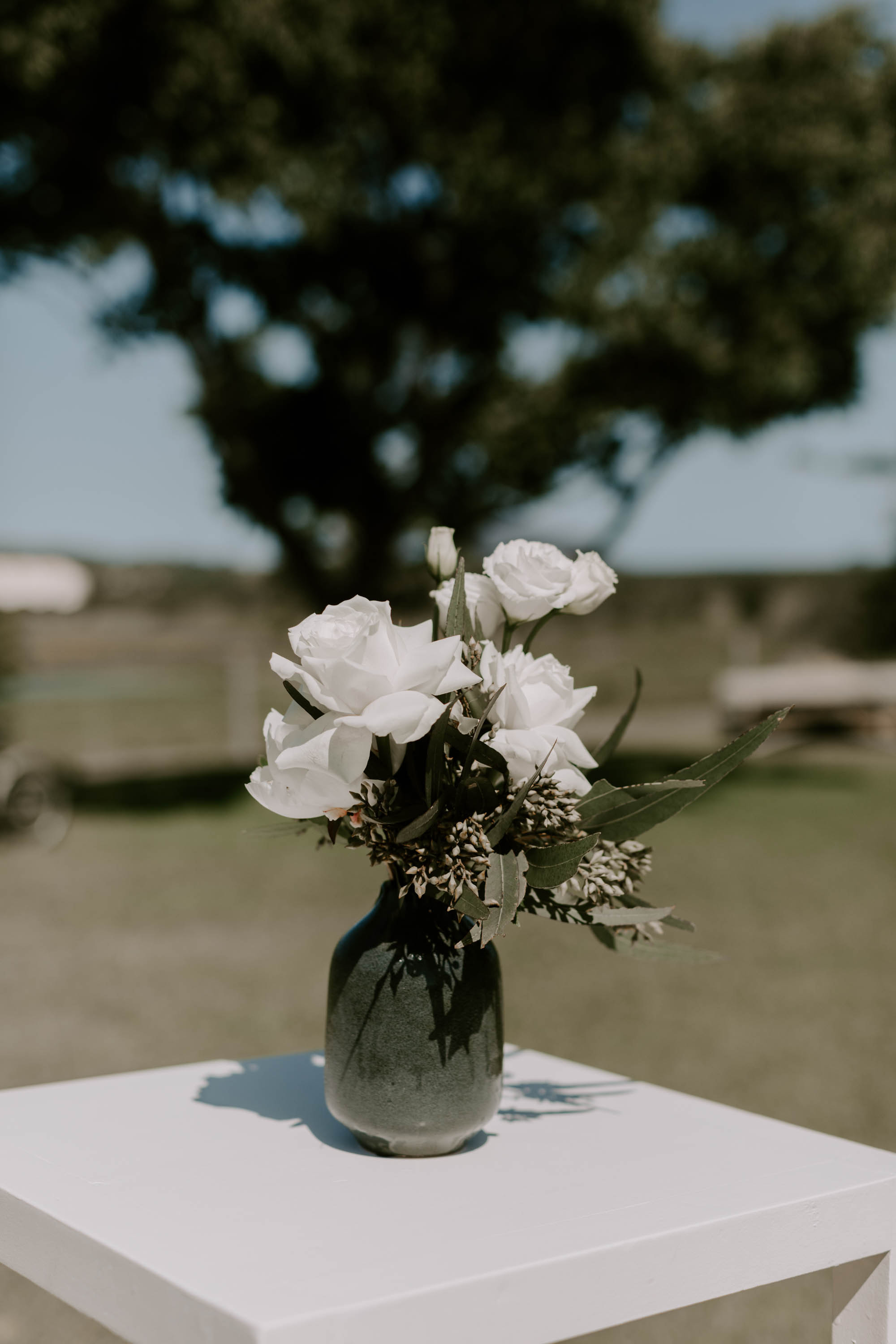 Garden party flowers featuring white roses and lush greenery