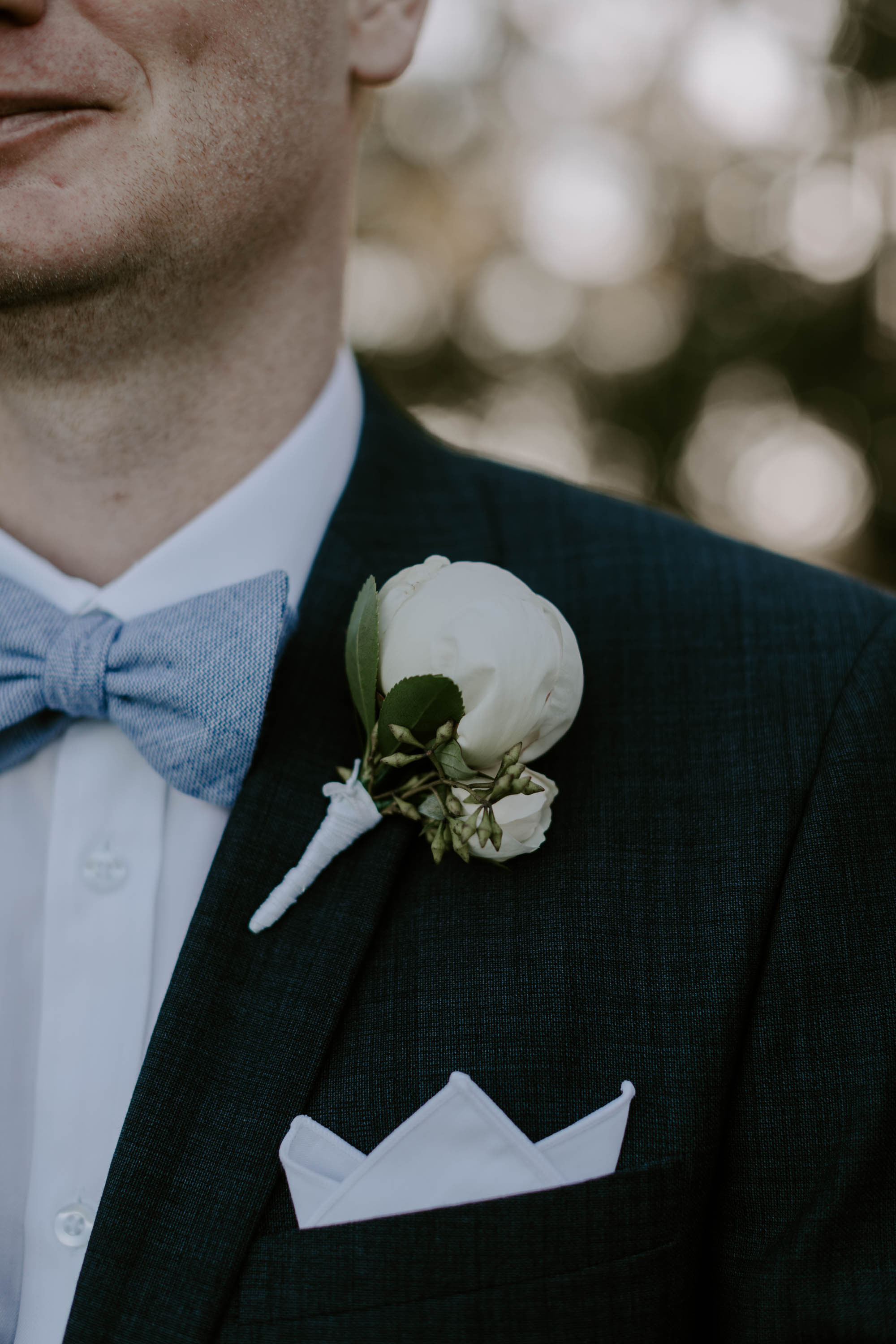 White buttonhole bloom design
