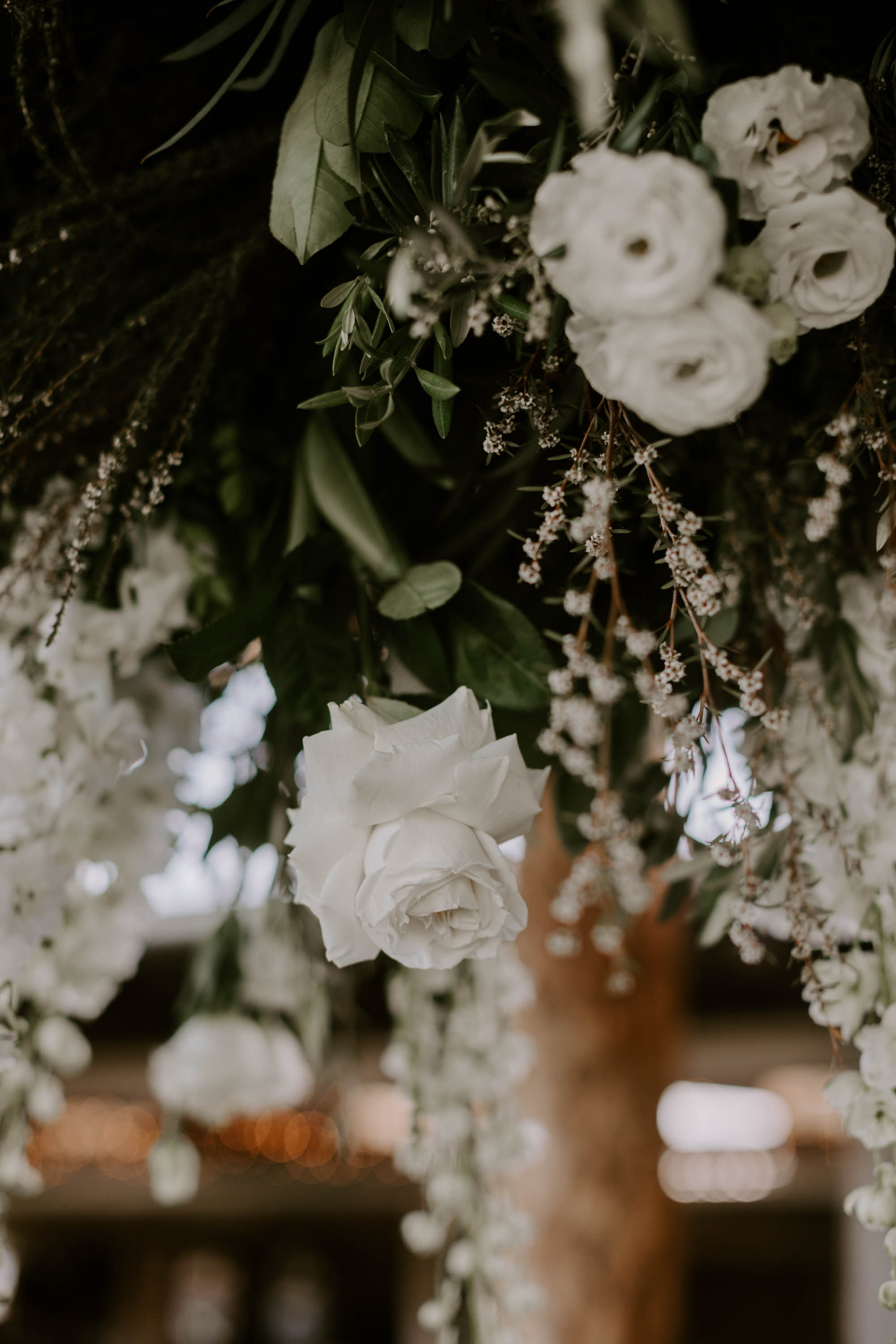 Hanging installation featuring white blooms