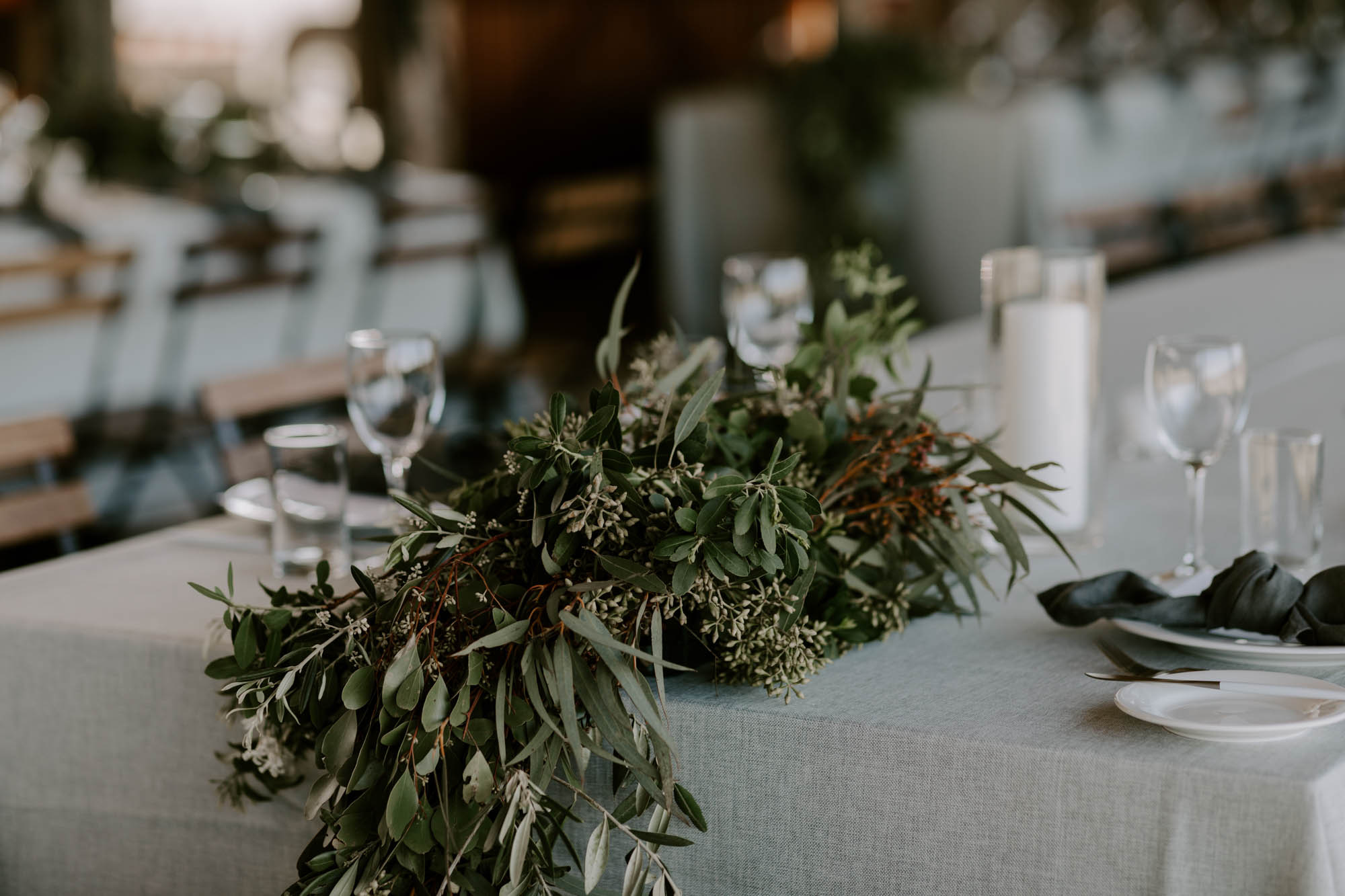 Reception lush table garland with rustic foliages