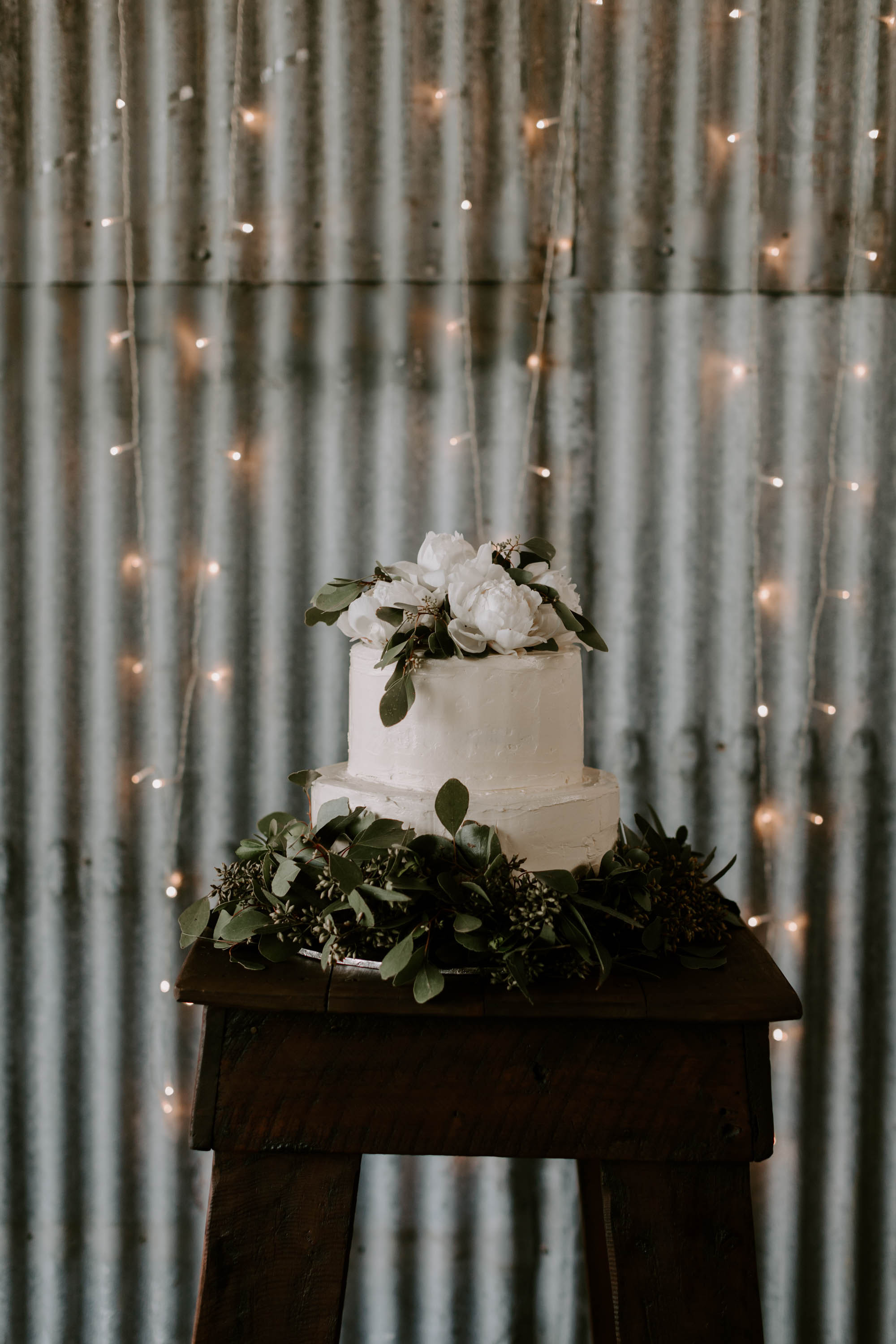 Wedding cake featuring white blooms and foliages