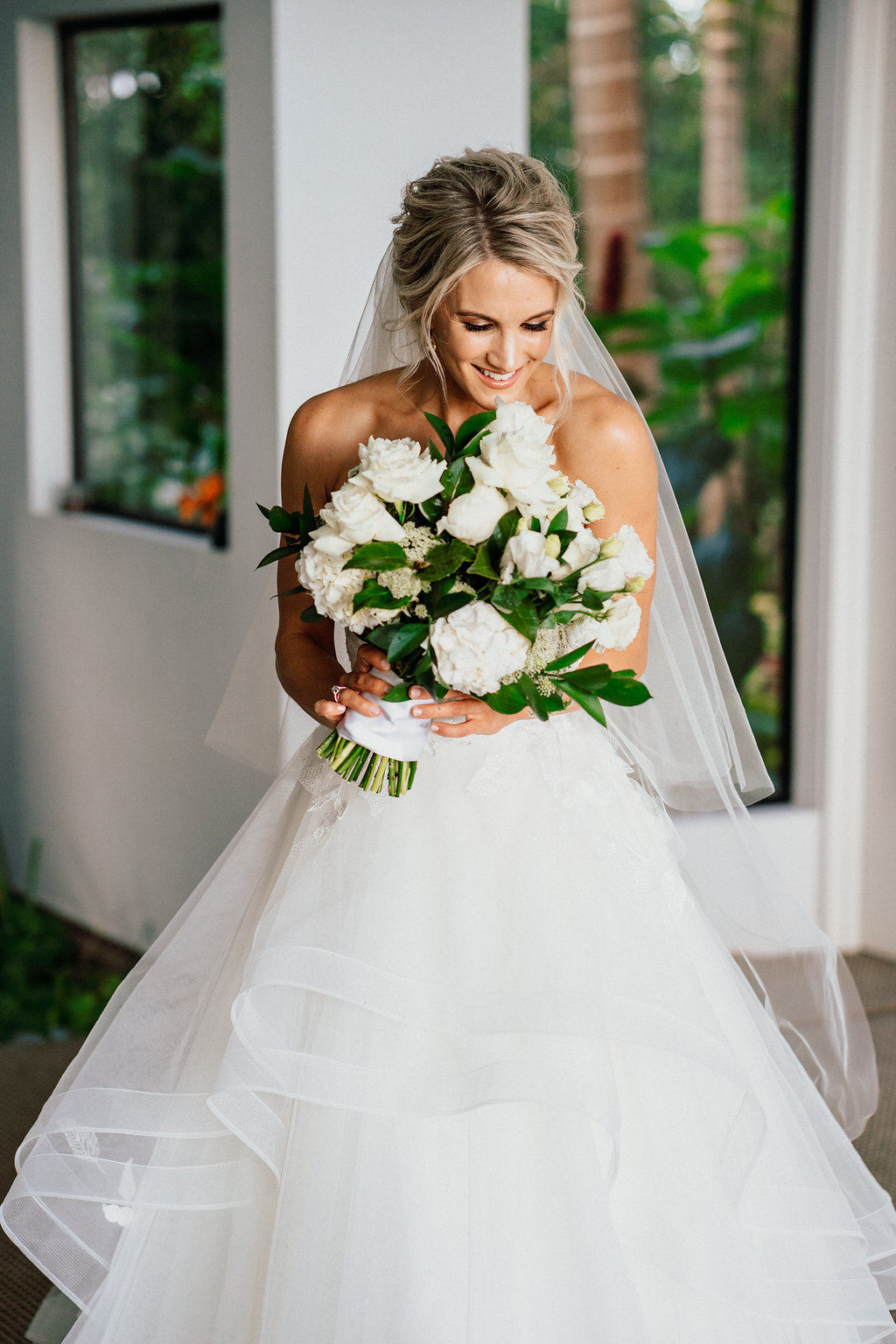 White and lush green bridal bouquet featuring roses