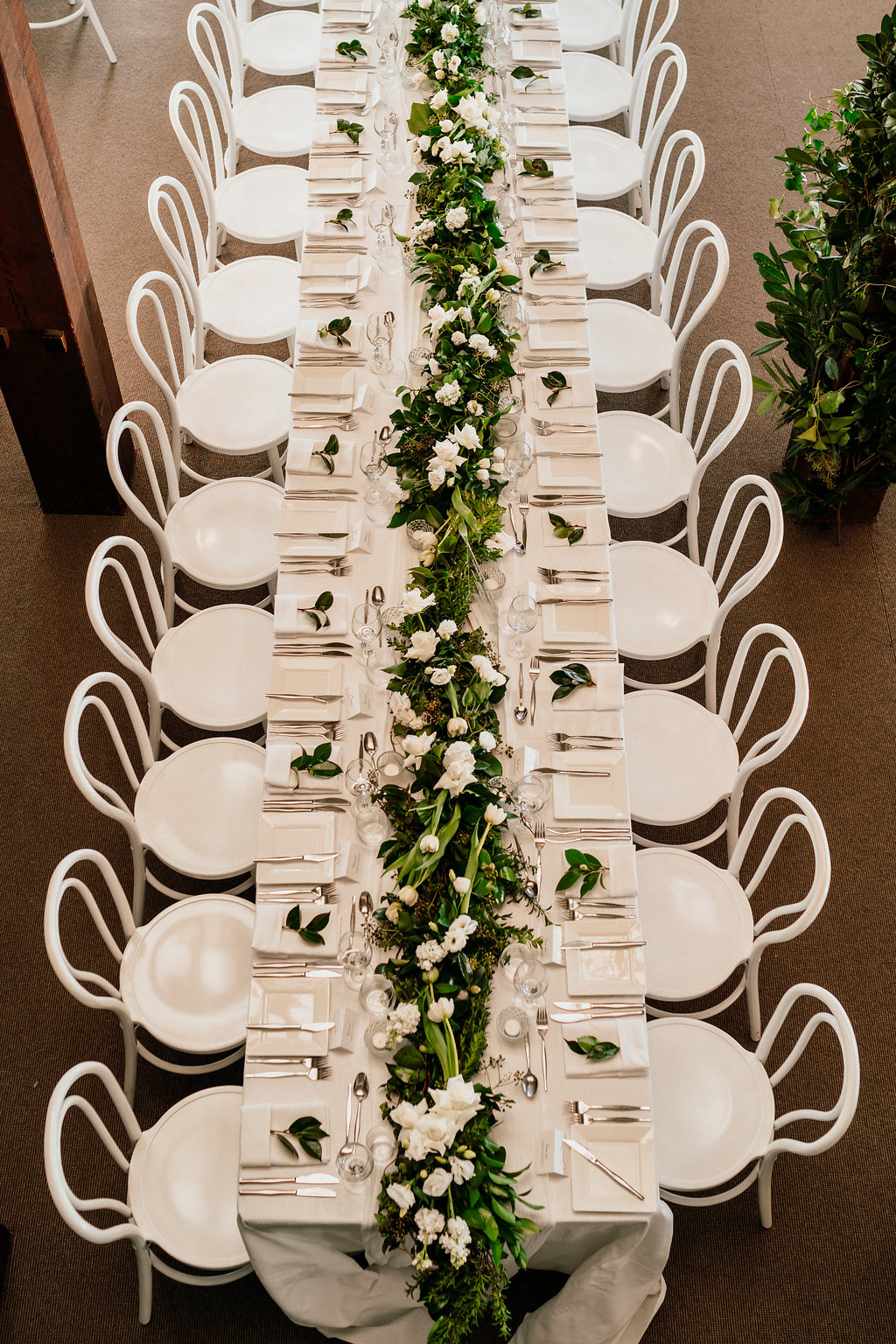 Lush reception table garlands with white blooms