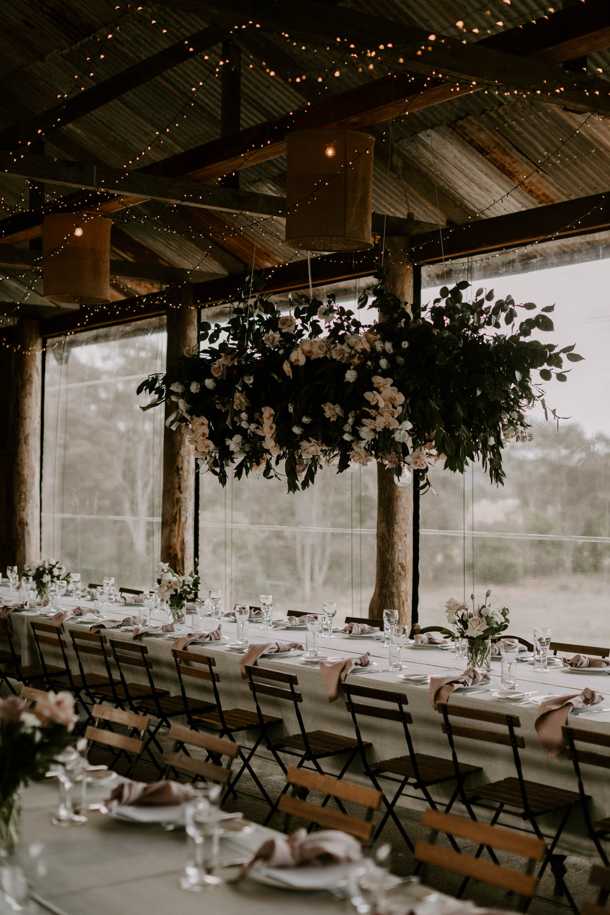 Hanging installation featuring antique pink roses and orchids